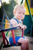 Baby in a swing — Stock Photo