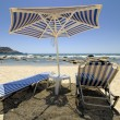 Umbrella and sun loungers  — Stock Photo