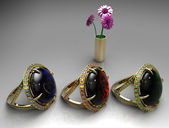Elegant female jewelry golden rings with flowers — Stock Photo