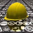 Yellow hard hat with signs of danger - Stock Photo