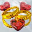 Stock Photo: Wedding rings and hearts