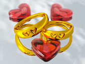 Wedding rings and hearts — Stock Photo