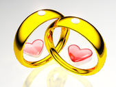 Wedding rings and hearts — Stockfoto