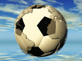The football and the earth — Stock Photo