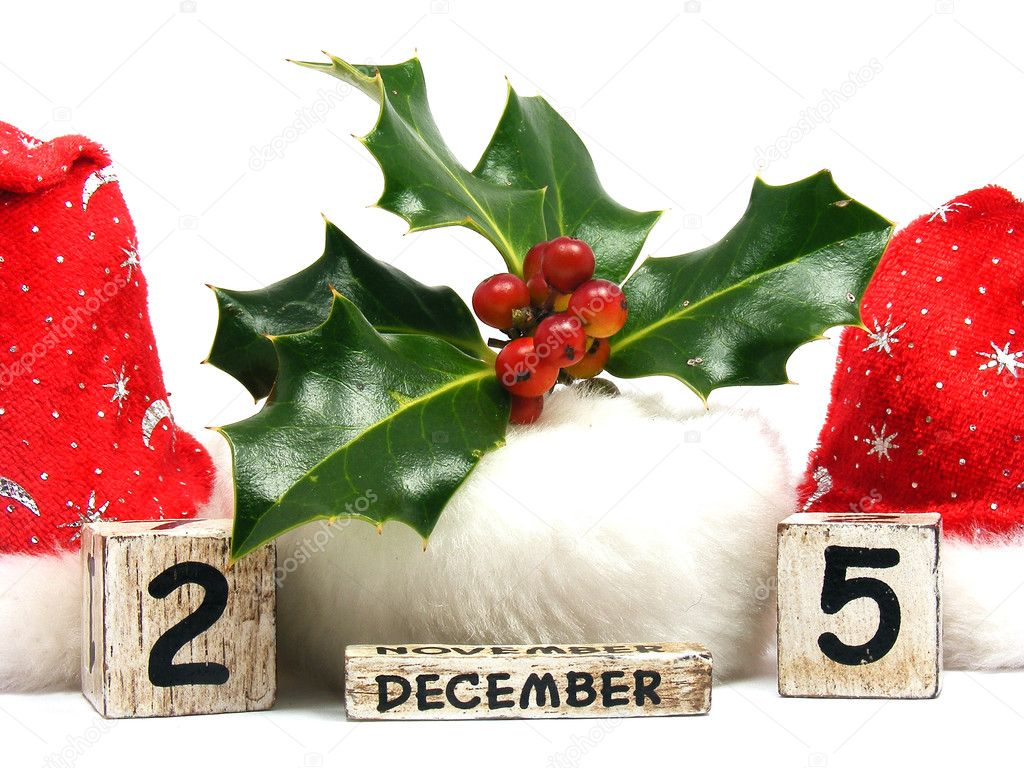 Christmas hats, holly and date blocks isolated over white  — Stock Photo #6589232
