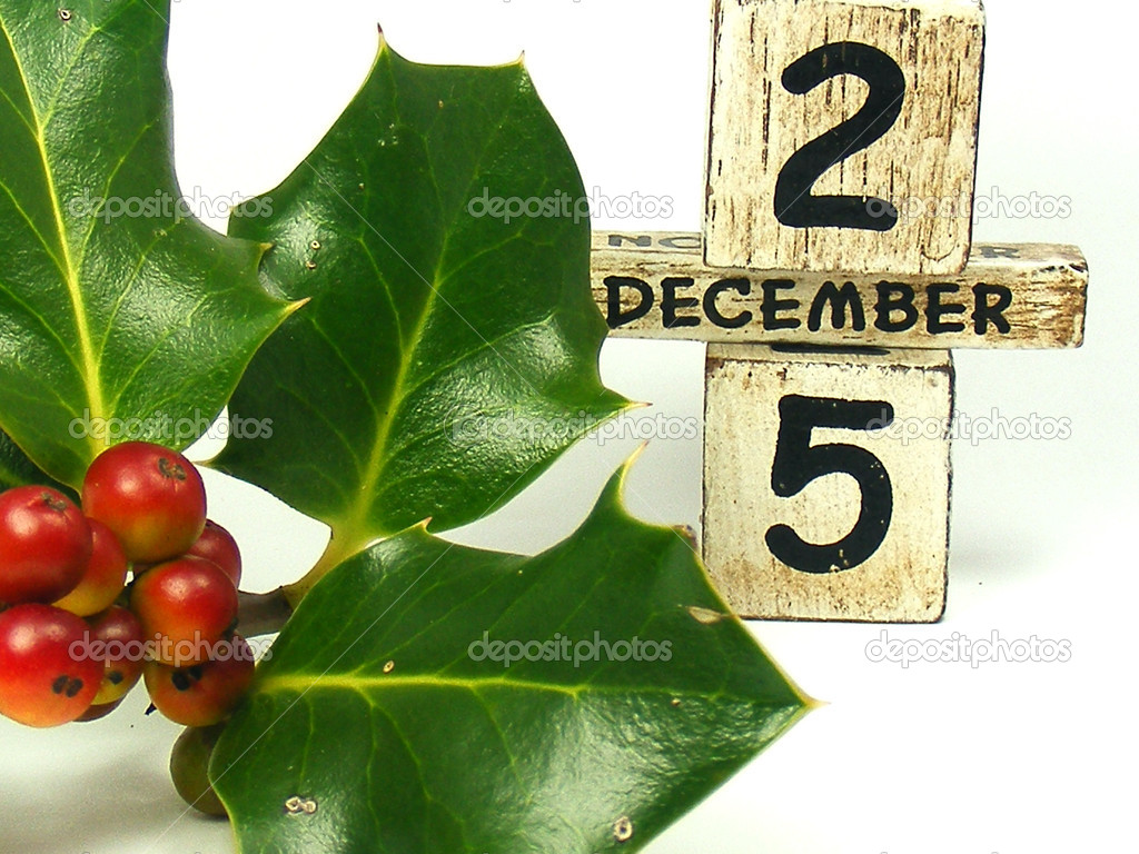 Christmas holly decoration with red berries and date blocks — Stock Photo #6589238