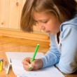 Stock Photo: Little girl draws