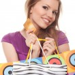 Positive woman with shopping bags and credit card — Stock Photo