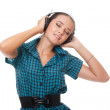 Beautiful young womrelaxation listening music in headphones — Stock Photo #6587722