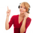 Young woman help line operator in headphones and shows a finger — Stock Photo #6678996
