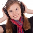 Smiling girl listening to music — Stock Photo #6740767