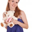 Girl with teddy bear in hands — Stock Photo
