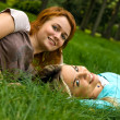 Two girls resting on the grass — Stock Photo