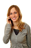 Woman talking mobile phone on white background — Stock Photo