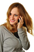 Closeup of cheerful woman having friendly conversation on cellph — Stock Photo