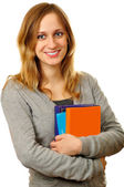 Friendly female student with books — Stock Photo