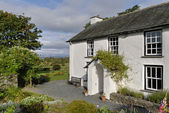 Whitewashed country cottage — Stock Photo