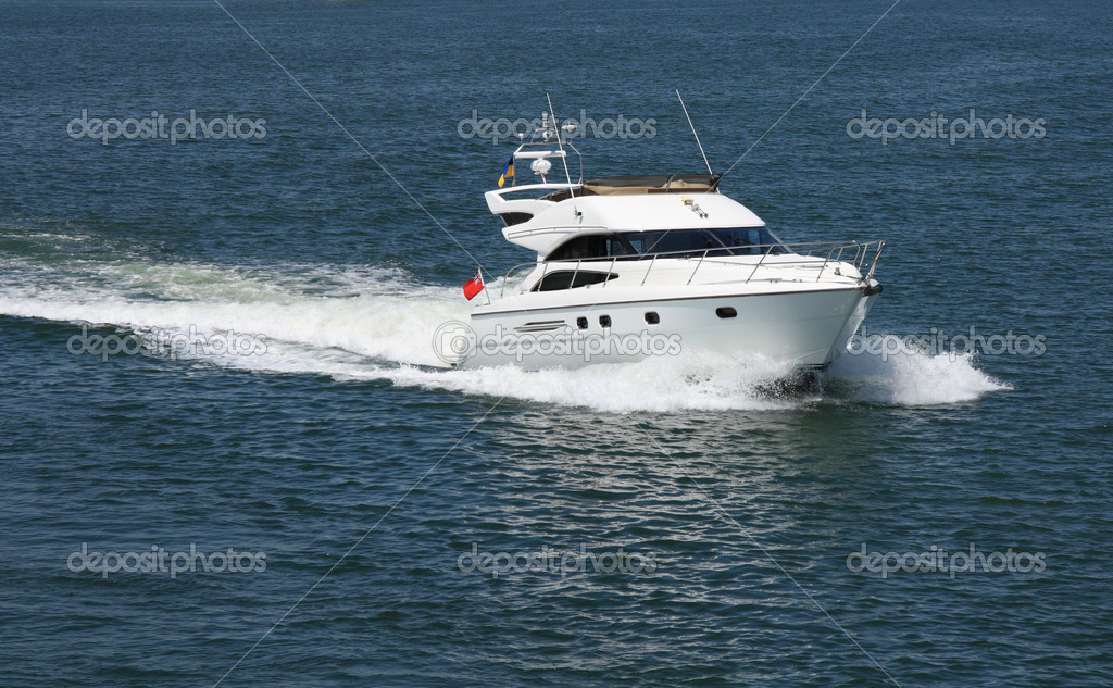 White speeding motor yacht at sea  Stock Photo #6617003