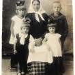 Ancient photo of grandmother with children — Stock Photo