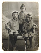 Ancient photo of sisters and brother — Stock Photo