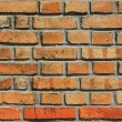 Cracking brick wall — Stock Photo