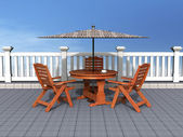 Outdoor patio with chairs and table — Stock Photo