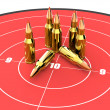 Stock Photo: Bullets on top of red target, ammo, ammunition