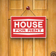 Stock Photo: House for rent sign on door, real estate, advertisement