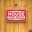 House for sale sign on door, real estate, advertisement - Stock Photo