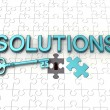 Stock Photo: Solutions text, key, jigsaw puzzle