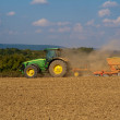 Tractor at work on farm — Stock Photo