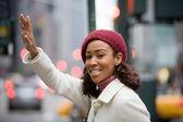 Woman Hailing A Cab — Stock Photo