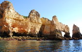 Caves in the cliffs yellow in Lagos in the Algarve Portugal — Stock Photo