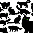 Cat's silhouettes with green eyes - Stock Photo