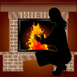 Stock Photo: Womis heated near fireplace
