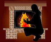Woman is heated near fireplace — Stock Photo