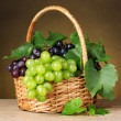 Ripe grapes in basket on yellow background — Stock Photo #6659800