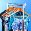 Royalty-Free Stock Photo: Different clothes on hangers