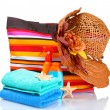 Bright striped beach bag and beach items — Stock Photo