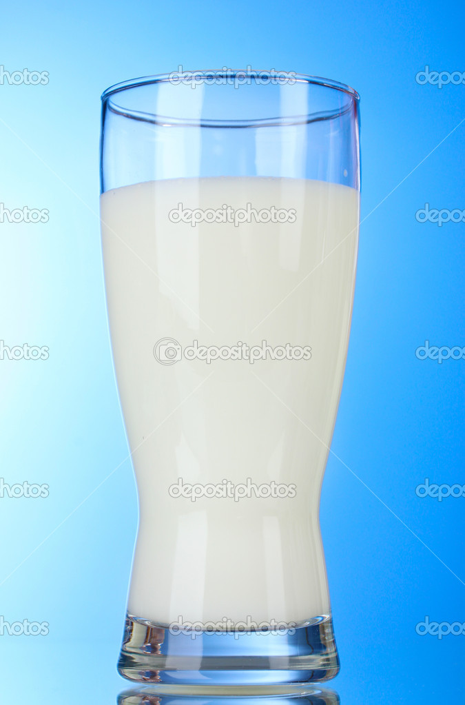 Tasty milk in glass on blue background  Stock Photo #6659769