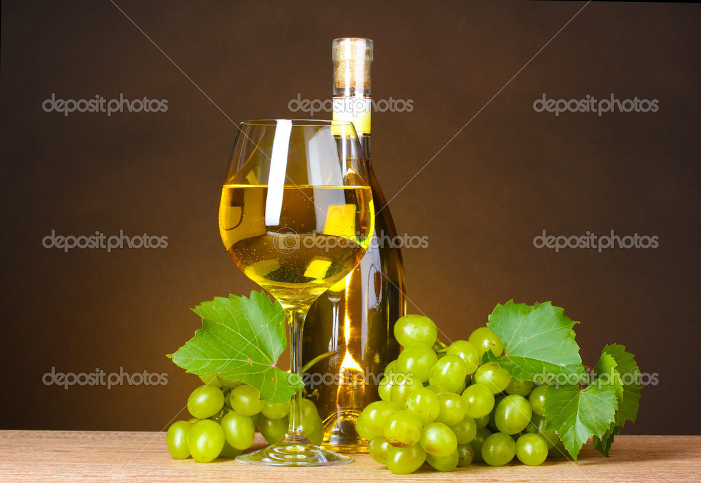 Glass of wine,bottle and grapes on yellow background — Stock Photo #6659827