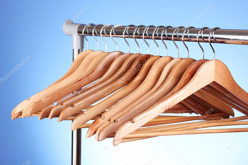 Wooden clothes hangers on blue background — Stock Photo #6659861