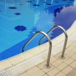 Swimming pool with stair at hotel close up — Stock Photo #6660390