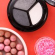Stock Photo: Many cosmetics on red background