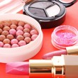 Royalty-Free Stock Photo: Many  cosmetics  on red background
