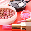Many cosmetics on red background — Stock Photo #6660592
