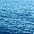 Blue water background surface with ripples - Stock Photo