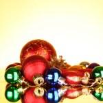 Many christmas toys on yellow background — Stock Photo