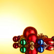 Stock Photo: Many christmas toys on yellow background