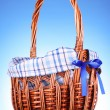 Wicker basket on blue background — Stock Photo #6660744
